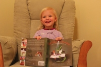 Edie and her copy of Eat Like a Dinosaur.